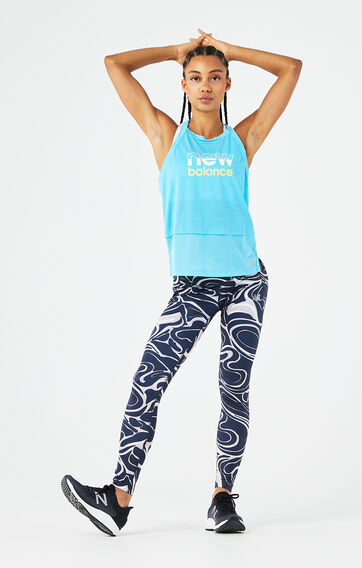 A woman wearing a blue tank and pattern tights from the Impact Run collection